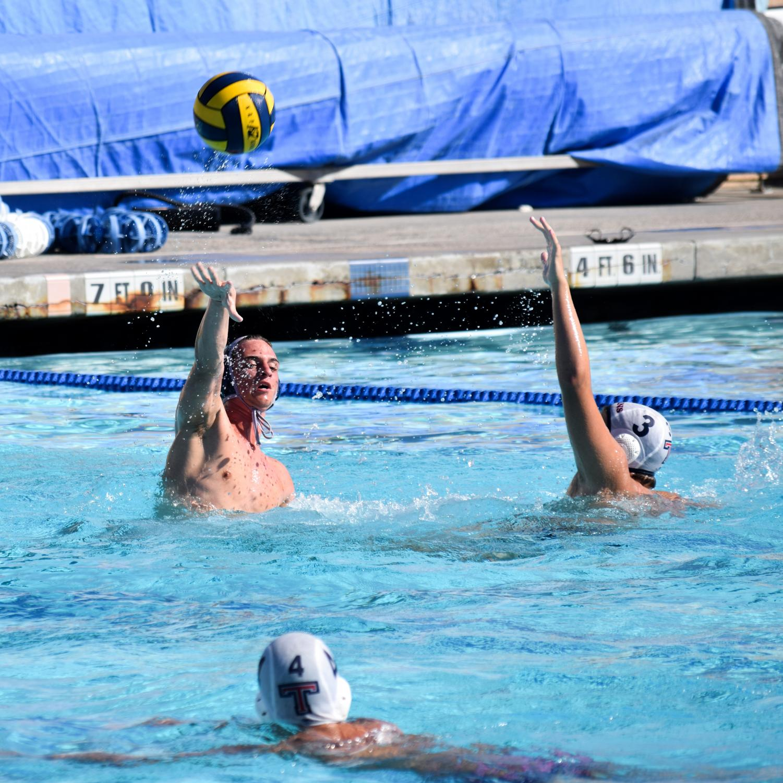 I'M OPEN!: Senior Nicholas Miceli flicks the ball to an open teammate.
