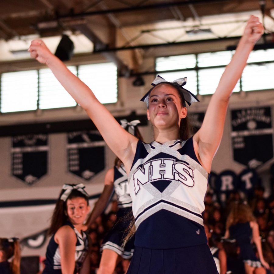 PEP RALLY, PEP SQUAD: Sophomore Chloe David lands a stunt.