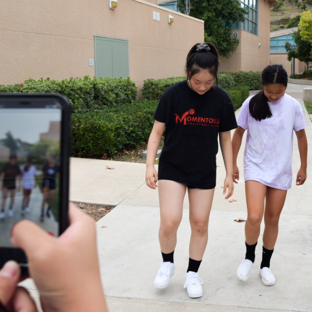CAN'T STOP WON'T STOP: (left to right) Freshmen Ariela Kao, Lindsey Kung and Neela Michaelsen practice for their new TikTok video.