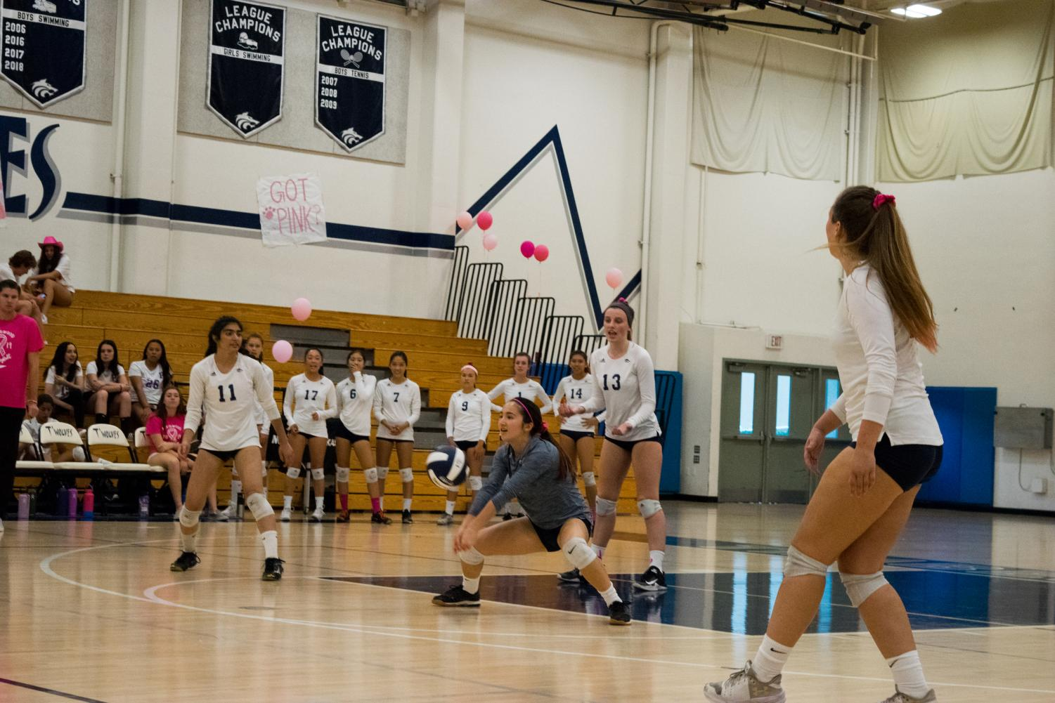 SQUARE UP: Junior Jen Li sets up the team's next play while her teammates get ready.