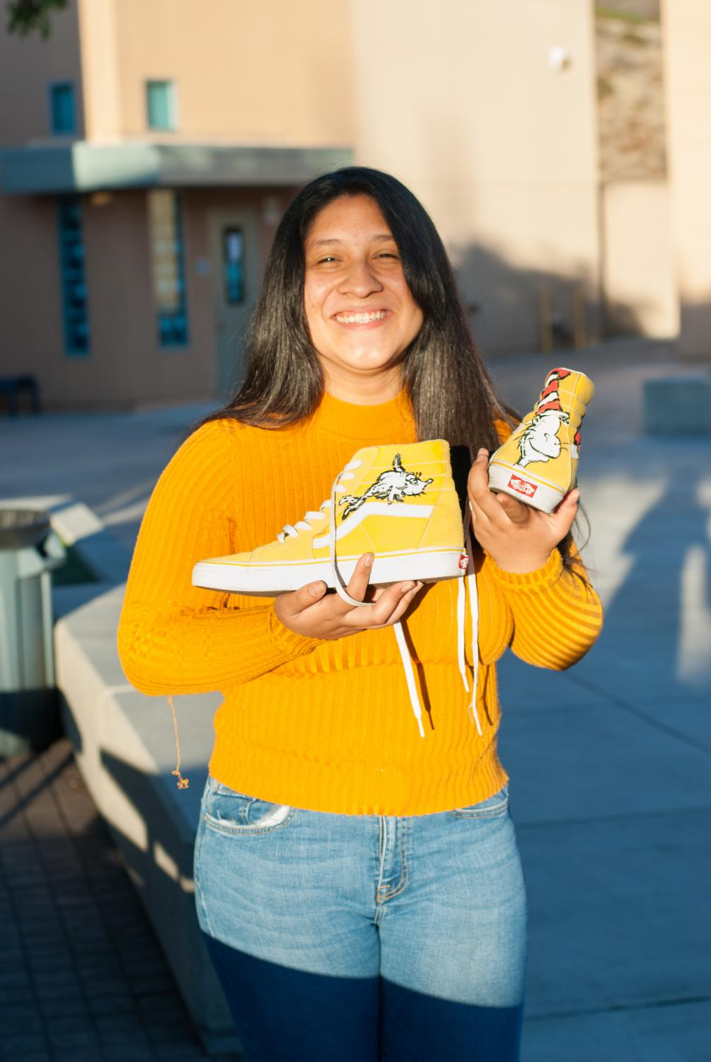 OH, THE PLACES SHE'LL GO: Check out how senior Brianna Vasquez personalized her sneakers by scanning the ZAPPAR logo on the newspaper.