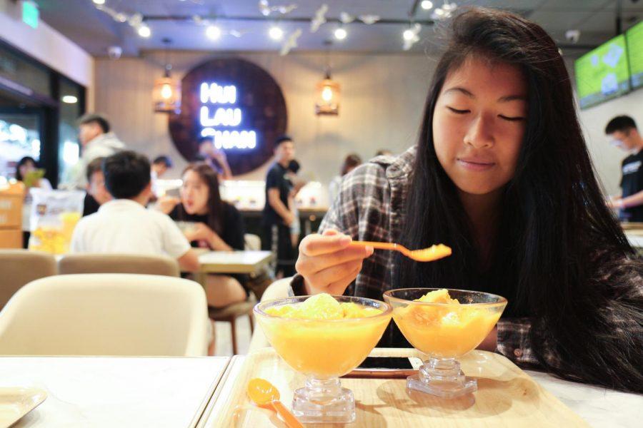MANGO%2C+GO%2C+GO%21%3A+Senior+Jadyn+Tiong+enjoys+the+refreshing+mango+sorbet+and+freshly+cubed+mangoes+in+Hui+Lau+Shan%E2%80%99s+signature+dessert.