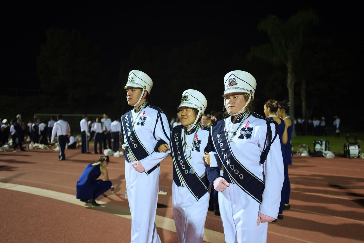 BAND TEN HUT: (left to right) Sepulveda, Fujimori and Miller prepare to call Marching Band to order.