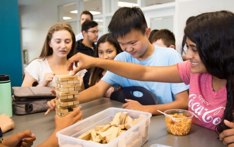COM(PACK)SION: Club members socialize through games such as Jenga.