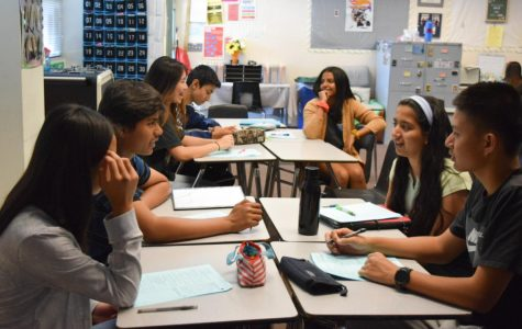 STAY ENGAGED! : Cell phones in the back keep the students on track