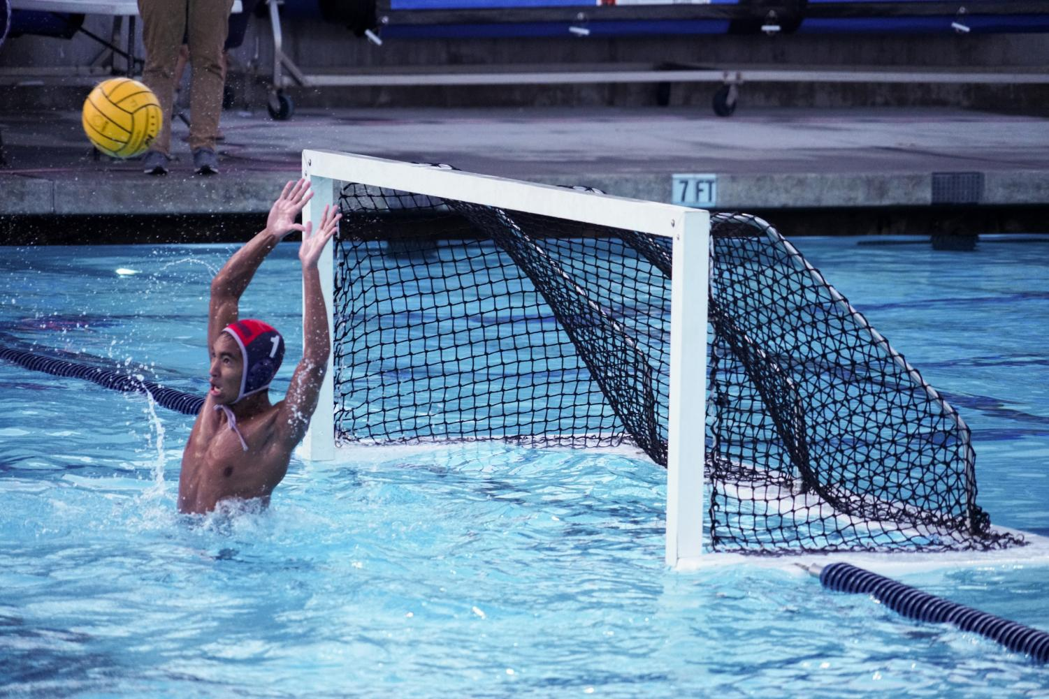 REJECTED!: Eyes on the ball and hands ready, senior goalie Adrian Fontao deflects the other team's shot.