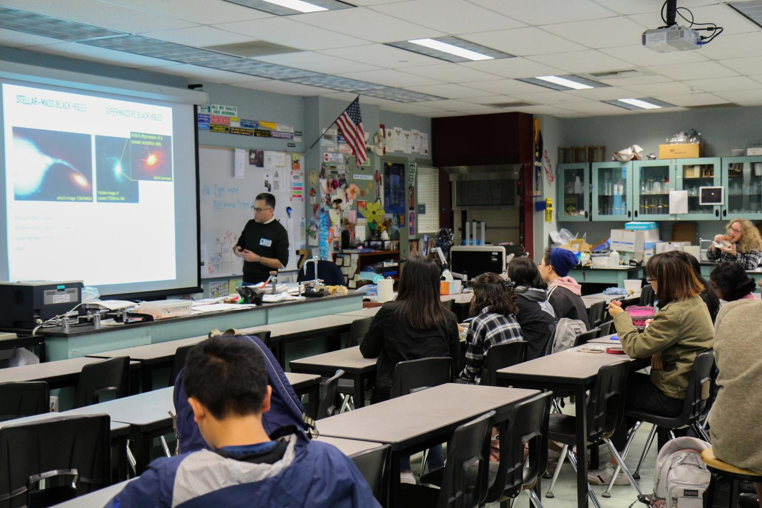 AN OUT-OF-THIS-WORLD MEETING: Astronomy Club members learn about black holes during lunch from a guest speaker.