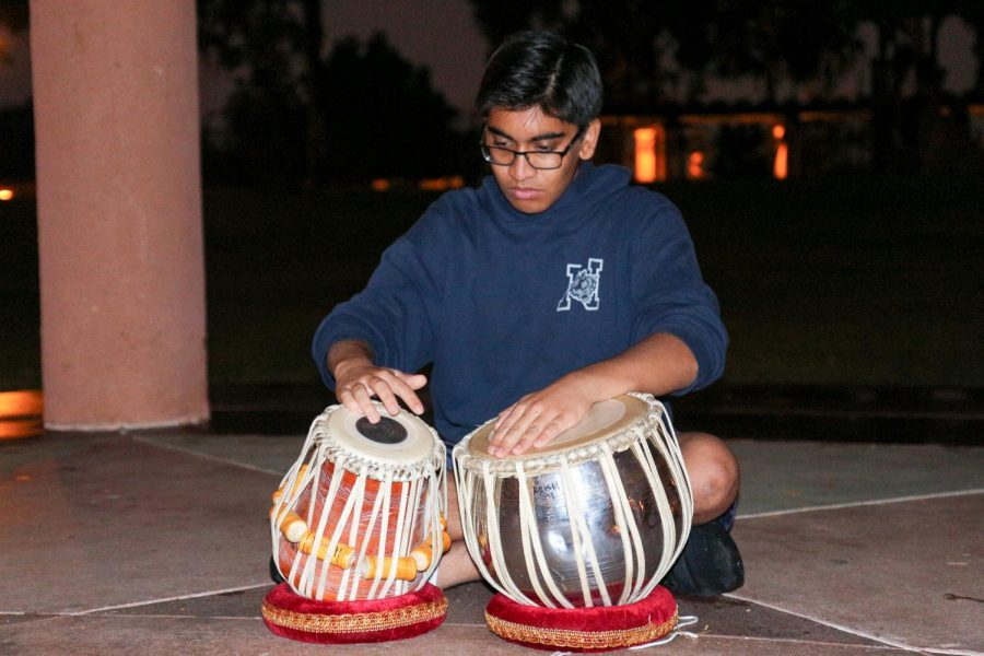 TABLA IT UP: Junior Krish Mehta jams out to the beat of the tabla as he practices.