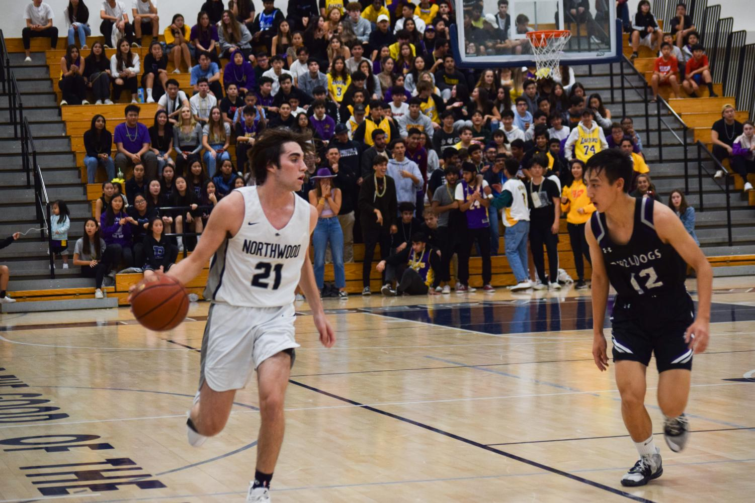 HOME COURT ADVANTAGE: Senior Shandon Sharifi carefully handles the ball against the Portola defender.