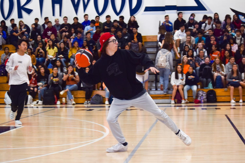 CLASH OR CRASH?: Sophomore Reid Okada aims at the freshmen team in the second dodgeball round.
