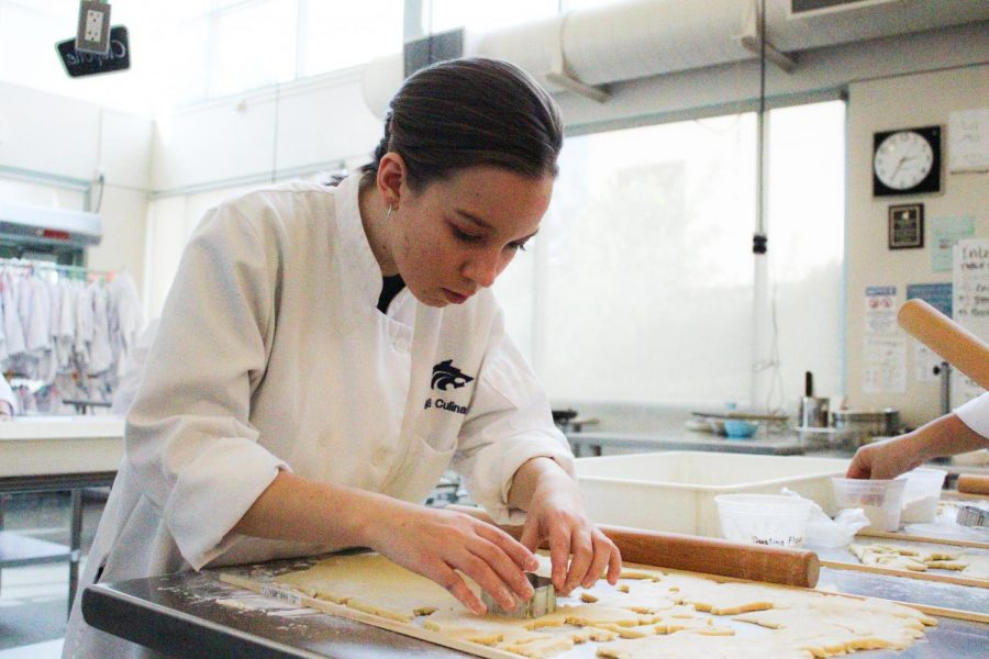 MAKING DREAMS CRUMB TRUE: Senior Alina Catiller finds her passion in culinary arts and works hard to bake a perfect batch of cookies.
