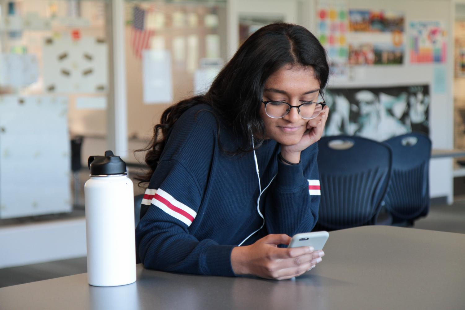 ORIGINAL OR INSPIRED?: Sophomore Gayatri Kalyan listens as she compares the classical and modern versions of two songs.