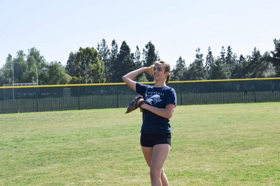 BATTER UP: Junior Kamryn Scott perfects her pitching technique.