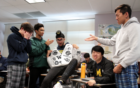 COLLEGE CRAZE: Senior Ekas Chawla disrupts peaceful AP Government class, annoying seniors (left to right) Ian Baick, Adrian Fontao, Eric Lin and David Xue with an ostentatious college flex. Do not disrupt AP Government. Do not be Ekas.