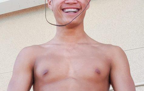 TWO WALKS OF LIFE: Junior Benjamin Liu prepares to get into the pool before swim practice.