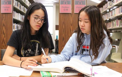 STAYING FOCUSED: Seniors Megan Lui (left) and Allison Huang (right) study for a classs together.