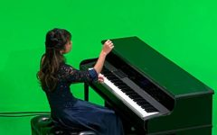 """IN HER FORTE: Senior Bethany Huang films her accompanying performance to """"The Star-Spangled Banner."""""""