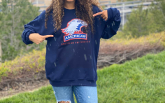 COLLEGE PRIDE: Senior Malak Hassouna shows off her American University gear and plans to pursue Women Studies and Pre-Law.