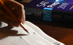 TEST PREP: A student attempts to solve practice problems to prepare for the SAT.
