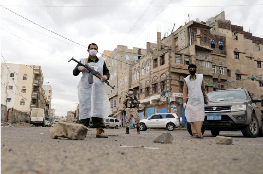 A+WAR+ON+TWO+FRONTS%3A+Armed+men+wear+masks+to+patrol+the+streets+of+Sanaa%2C+Yemen%2C+during+a+24-hour+curfew%2C+as+concerns+regarding+COVID-19+grow.+%0A