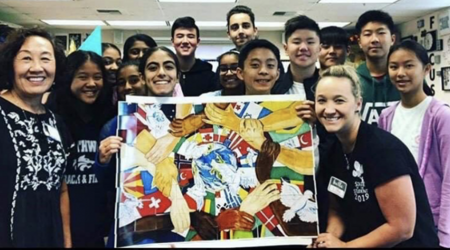 BETTER TOGETHER: National History Day club puts together a history puzzle on State of the Student.