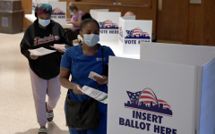 People continue to cast their ballots in-person during the primary election despite the pandemic.