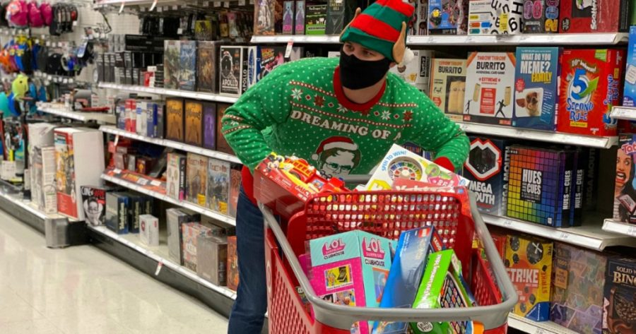 IT'S BEGINNING TO LOOK A LOT LIKE BLACK FRIDAY: A masked shopper suspiciously searches for deals and low-quality holiday presents at their local Target.