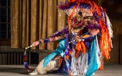Native American Samsoche Sampson performs a dance at a Native American Heritage Month celebration.