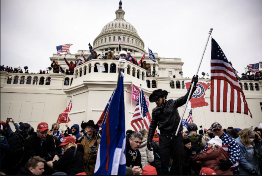 Capitol Chaos: With Trump flags and Confederate symbols in hand, Pro-Trump rioters swarm the U.S. Capitol after rallying together and breaching security.