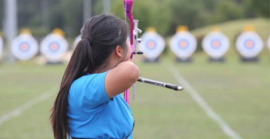 FOR ARROW DYNAMICS: Junior Richelle Shim adjusts her bow to hit the perfect shot.