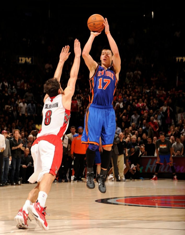 Buzzer beater: Jeremy Lin scores a last-second game winning shot over Jose Calderon.