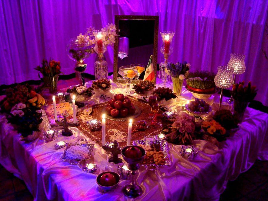 A half-sin table spread of sabzeh (سبزه) – grown sprouts, samanu (سمنو) – sweet pudding, senjed (سنجد) – Persian olive, serkeh (سرکه) – vinegar, seeb (سیب) – apple, seer (سیر) – garlic, and somāq (سماق) – sumac.