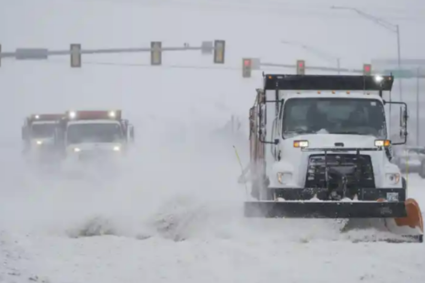 Drivers of snow-removal vehicles battle freezing temperatures, clearing routes for escaping the bitter cold.