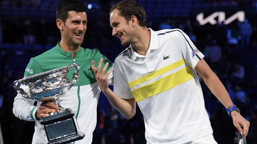 Djokovic+jokes+with+Medvedev+during+the+Australian+Open+trophy+presentation
