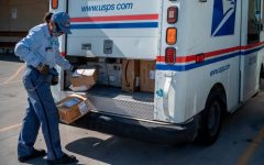 DELIVERING FOR AMERICA: A USPS driver delivers packages in the early months of the COVID-19 pandemic.