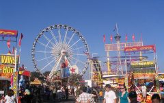 AN EXCITING RETURN: Fairgoers browse the OC Fair's midway, finding interest in the endless amusement rides, carnival games and concession stands.