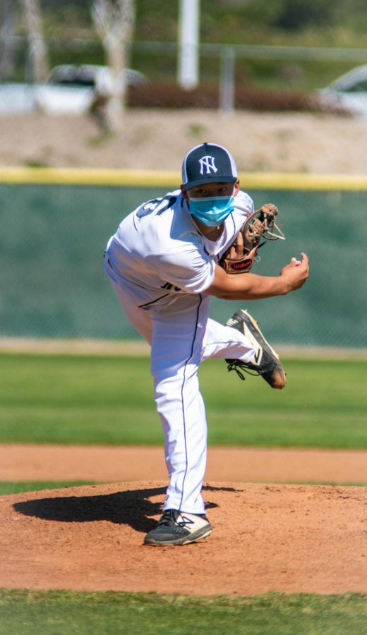 STRIKE-OUT: Junior Ethan Chen pitches a heater to a batter.