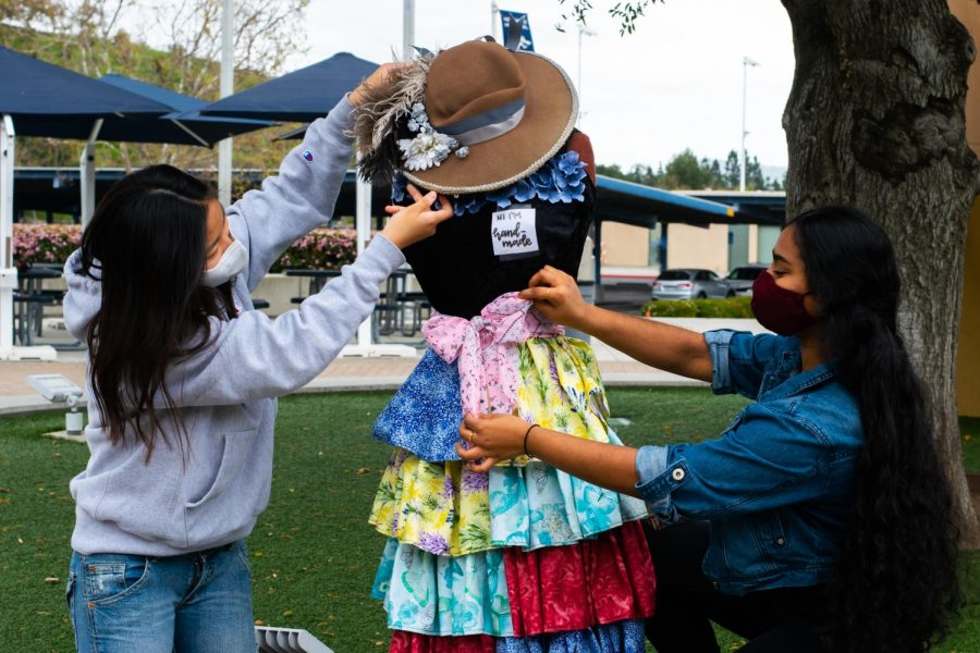 SETTING UP FOR SUCCESS: Incoming ASB officers and juniors Snigdha Maddula and Yun Seo Lee help creatively decorate a mannequin for Northwood's annual Fine Arts Week event, celebrating all types of art.