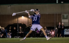 BORN TO LAX: Senior Ethan Koers propels the ball to a teammate as the long-stick midfielder in a game against Edison High School.