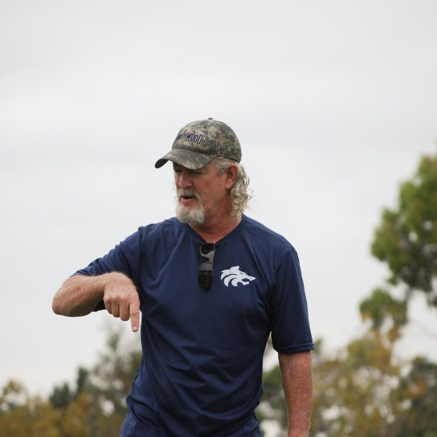 CONSTRUCTIVE COACHING: Clarke offers a football player guidance and advice on how to improve an offensive play.