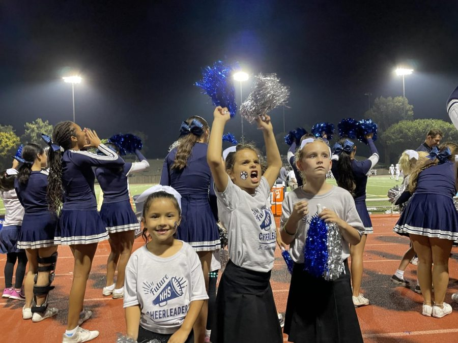 YOU+WISH+YOU+WERE+A+T-WOLF%3A+Junior+Timberwolves+encourage+the+crowd+to+cheer+at+a+football+game.